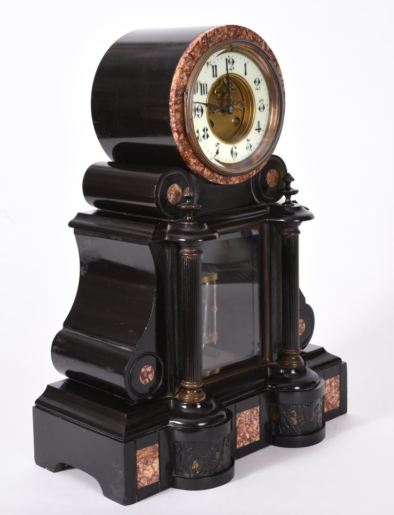 Beautiful antique French marble and bronze mantle clock . This clock is great working antique condition. The mantle clock stand about 17 inches high X 13 inches length X 5.5 inches width.