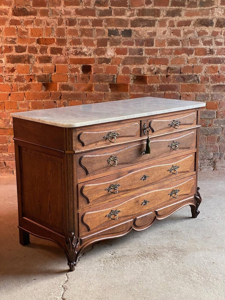 Antique French marble chest of drawers commode France circa 1890 number 12  Beautiful French antique marble topped oak commode chest of drawers, circa 1890, this chest dates to the late 19th century, the elegant white with grey veins marble top