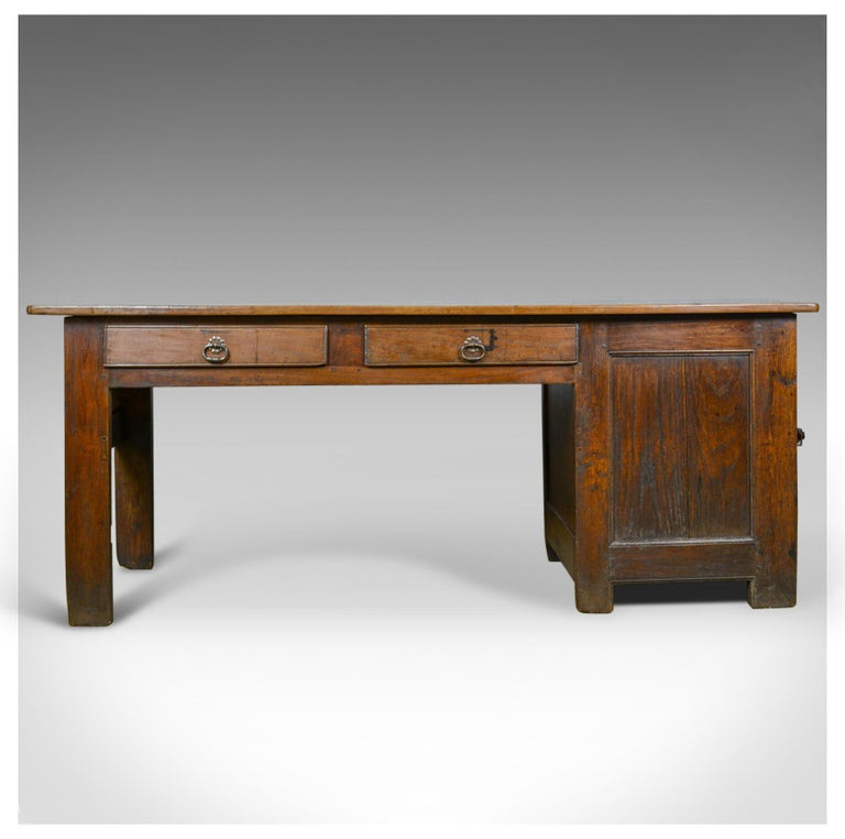 This is an antique French Mayoral clerk's desk. An oak and elm table dating to the mid-19th century, circa 1850.  A substantial and heavy French oak clerk's desk The stout stocks of oak and elm displaying good color throughout Of pegged