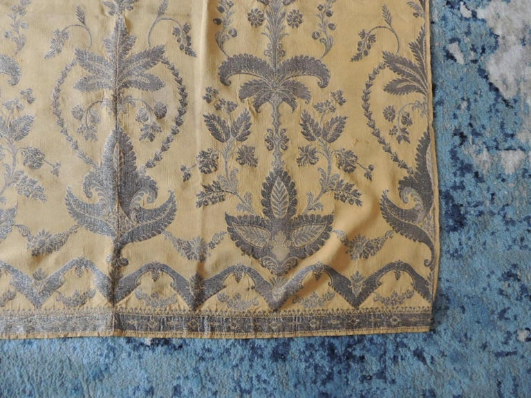 Antique French metallic threads embroidered on gold silk panel. Heavy tarnish color silver threads. 3-panel attached together before embroidered was finish. Ideal as a wall hanging or underline it as use it as a throw. Size: 42