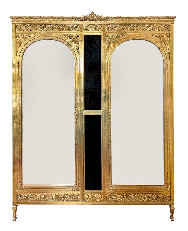 Antique French Napoleon III style wardrobe, circa 1900.  All the construction and legs are made in bronze, sides with black colour glass, front doors with mirror in the arc shape facades. The wardrobe is decorated with bronze elements. Inside the