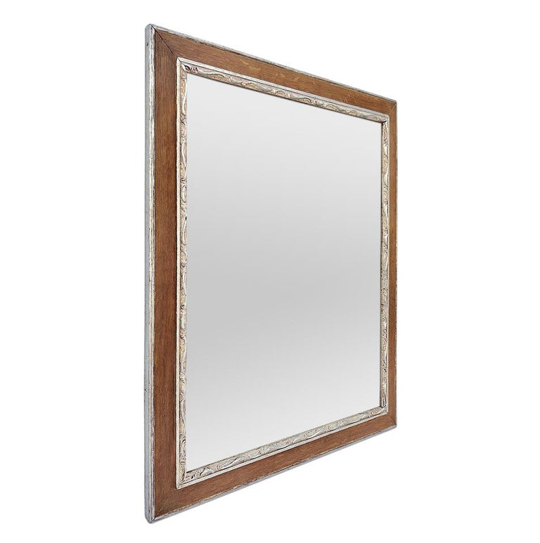 Antique oak wood mirror with silvered wood stylized decors, circa 1940. Re-gilding to the leaf patinated. Antique frame width: 1.96 in / 5 cm. Modern mirror glass. Antique wood back.