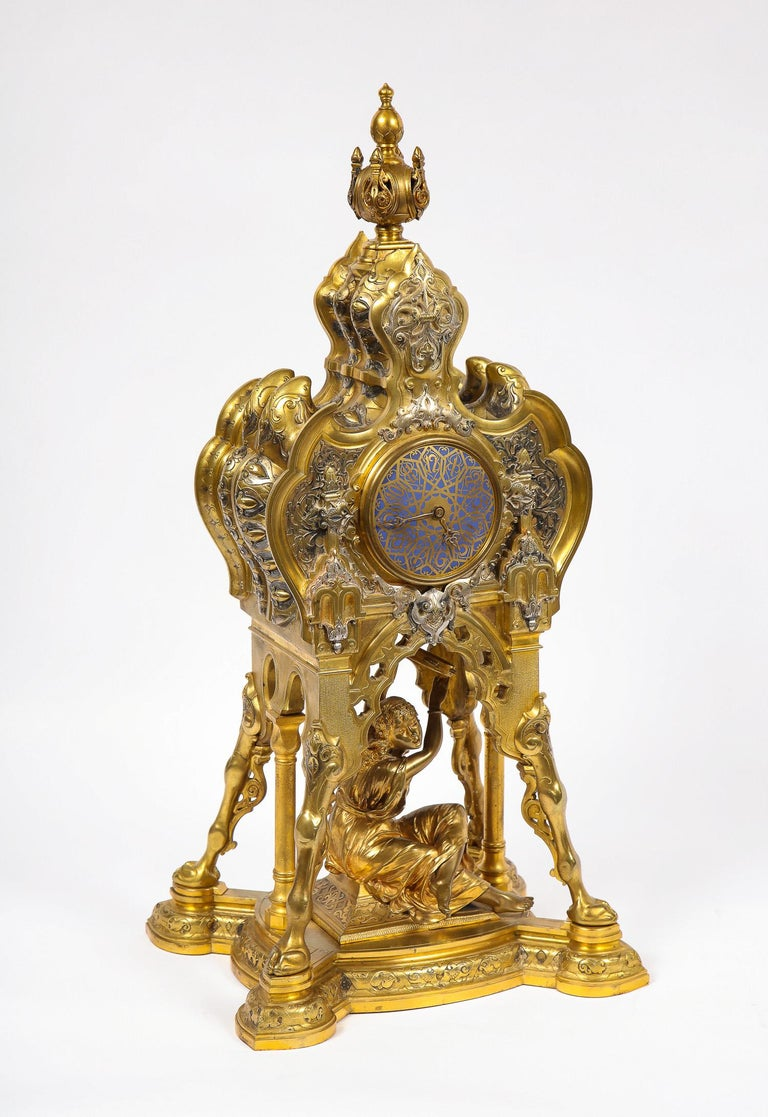 A very unusual 19th century antique French orientalist/Moorish silvered bronze, gilt bronze and champleve enamel figural clock, signed Boulez, marks on movement ROBLIN & FILS FRERES, A Paris, 32499. Found in the middle of the clock is a seated