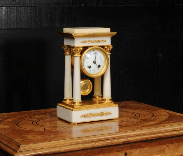 Neoclassical Antique French Ormolu and White Marble Portico Clock For Sale