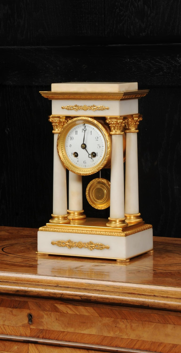 19th Century Antique French Ormolu and White Marble Portico Clock For Sale