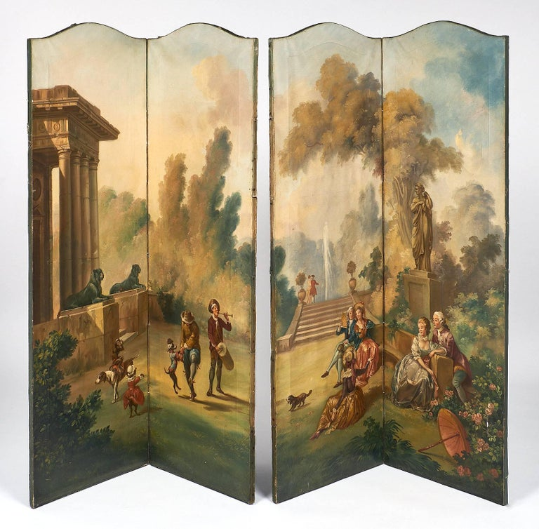 """A French antique painted canvas screen with four panels featuring hand painted decor in a romantic pastorale fashion. Impressive architectural """" a L'Antique"""" and various romantic scenes are depicted in the foreground, along with monkeys and"""