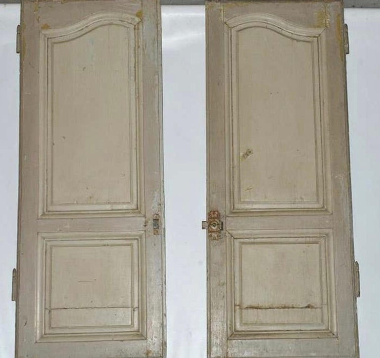 Slightly distressed French Provincial paneled doors for a cabinet this striking pair of doors wear their age with grace, and would bring character in creating a cupboard for storage, pantry in a kitchen or a standalone cabinet. They also work