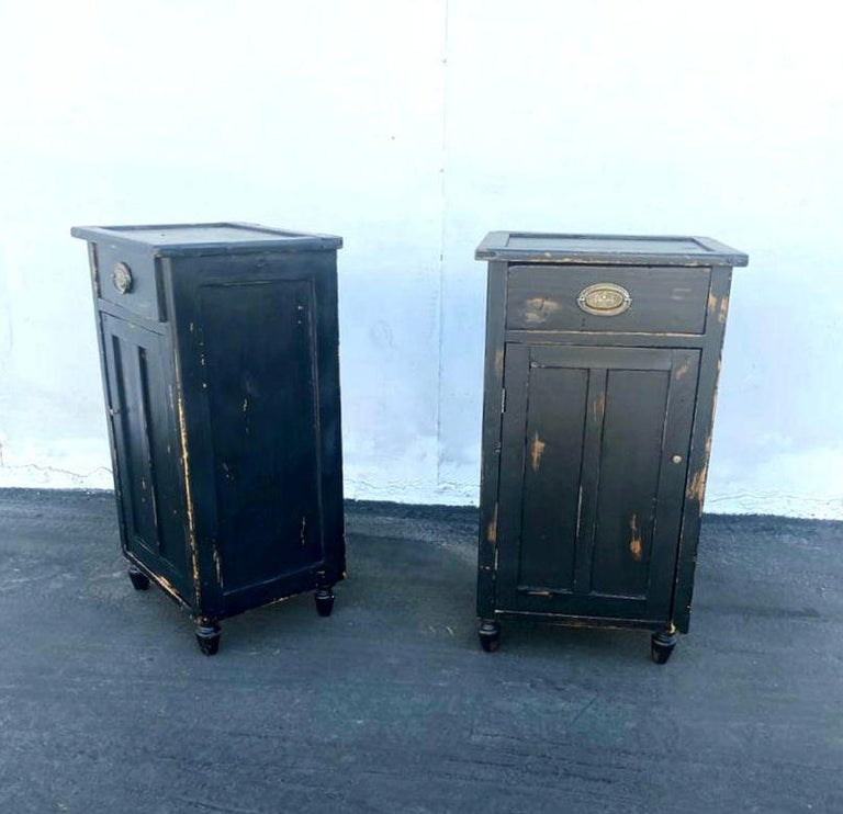 Black wood night stands, on the top is black glass, brass hardware. Distress original look and functional.