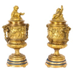 French Pair Two-Tone Gilt Bronze Lidded Urns with Cherub Finials, 19th Century