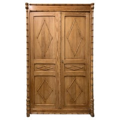 Antique French Pine Two-Door Armoire with Faux Bamboo Carved Motif