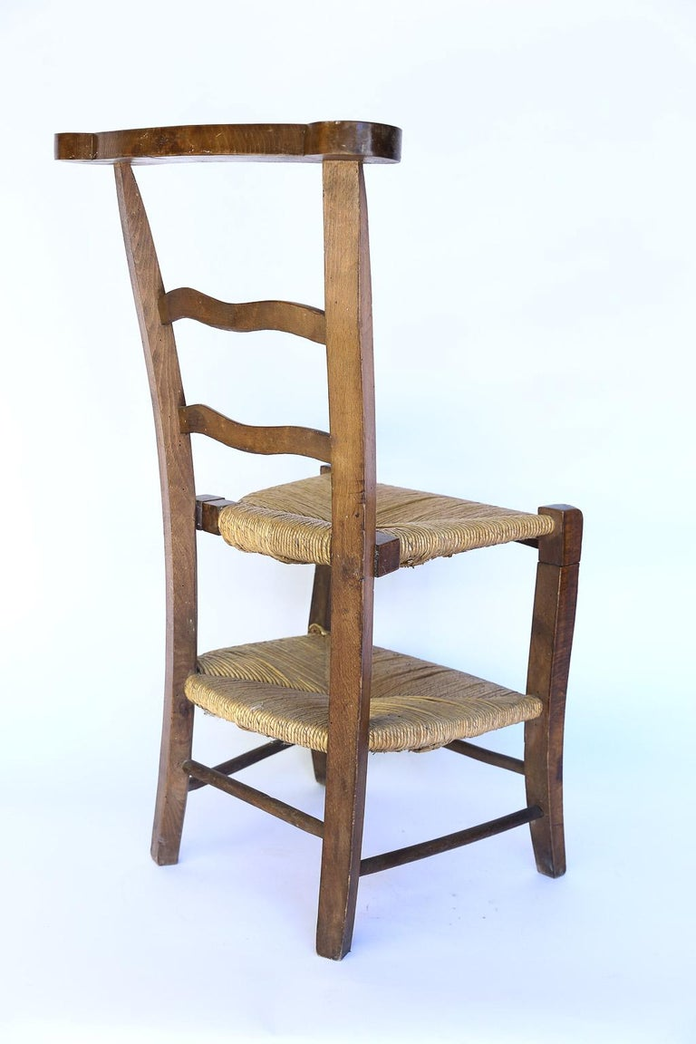 This charming prie dieu was once used in a French church as both chair and kneeler. The 17.5