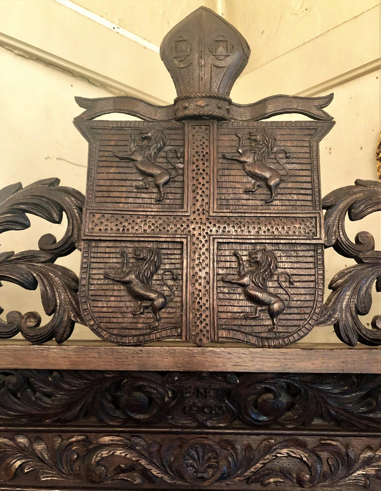 Antique French Provincial Ornately Carved Oak Corner Cabinet with Heraldic Crest In Excellent Condition For Sale In New Orleans, LA