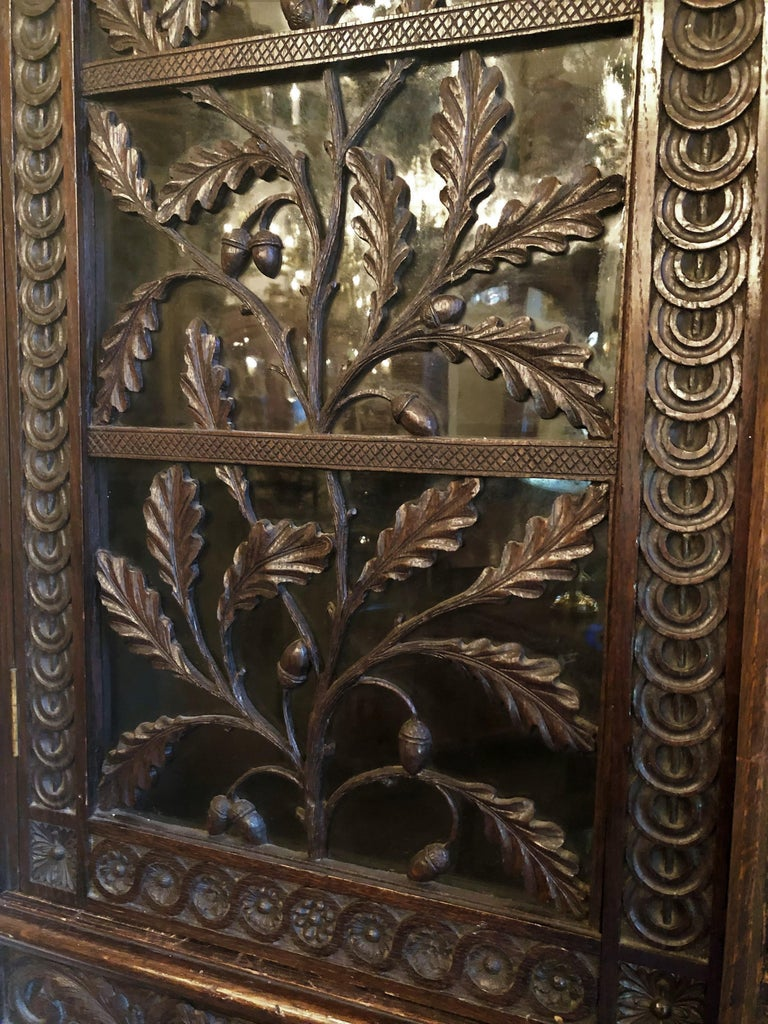 Antique French Provincial Ornately Carved Oak Corner Cabinet with Heraldic Crest For Sale 1