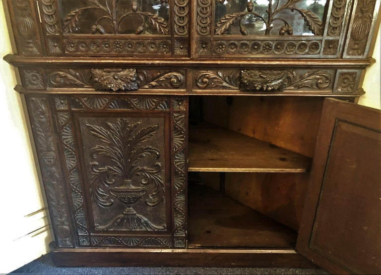Antique French Provincial Ornately Carved Oak Corner Cabinet with Heraldic Crest For Sale 2
