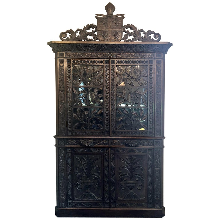 Antique French Provincial Ornately Carved Oak Corner Cabinet with Heraldic Crest For Sale
