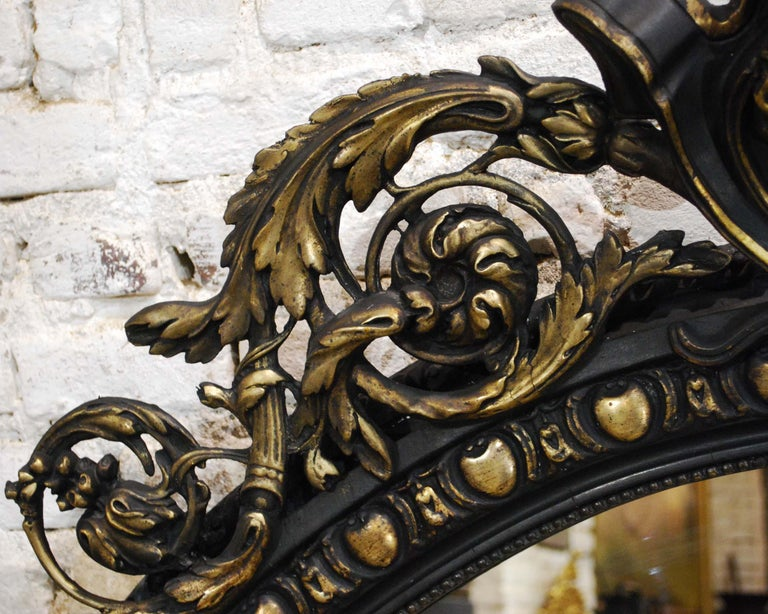 Gesso Antique French Renaissance Style Black and Gold Mirror with Carved Ornaments For Sale