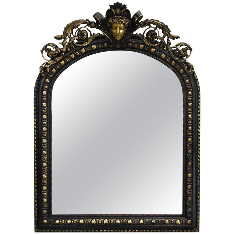 Antique French Renaissance Style Black and Gold Mirror with Carved Ornaments For Sale
