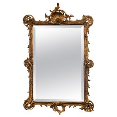 Antique French Rococo Style Carved Gilt Wood Beveled Mirror, Circa 1890-1900