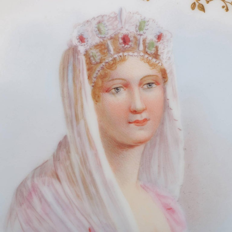Antique French Sevres porcelain hand-painted porcelain portrait plate features central portrait of crowned princess artist signed lower right, scalloped border with floral reserves and gilt foliate and scroll accents, en verso with