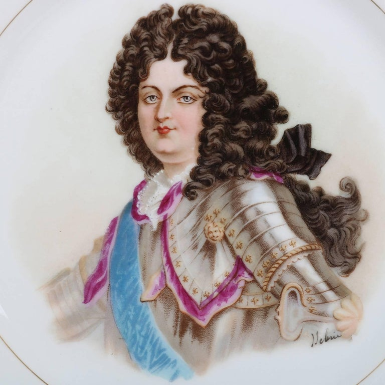 Antique French portrait plate by Sevres for Chateau de St Cloud features well with central artist signed portrait of Louis XIV by Debrie, rim with gilt scalloped edges and decorated with cranberry and gilt, en verso stamped