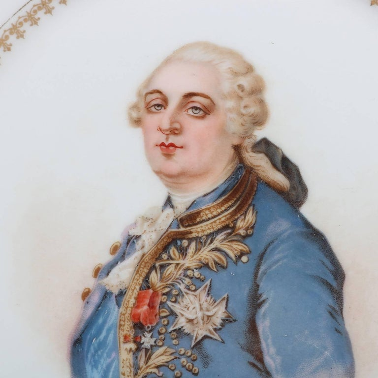 Antique French portrait plate by Sevres for Chateau de St Cloud features well with central artist signed portrait of Louis XVI by Debrie and framed with gilt repeating and stylized fleur-de-lis pattern, rim with gilt scalloped edges and decorated