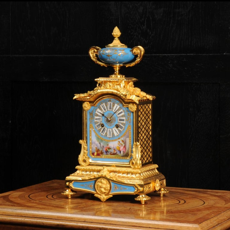 A fine and stunning original antique French boudoir clock. It is beautifully made of ormolu (finely gilded bronze), very well modelled and chased, and mounted with exquisite Serves style porcelain. The ormolu is in stunning, untouched, original