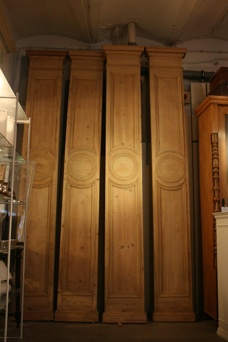 Very rare original antique 4-part cladding (see last picture) from an old shop facade from Paris, circa 1900. Completely made of softwood and already leached years ago.  In very good condition.  Dimensions per piece: 360 cm high, 45 cm wide, 10