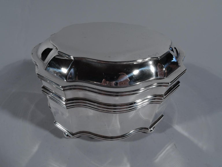 Classical 950 silver box. Made by Auguste Leroy in Paris, circa 1920. Curvilinear shaped oval. Cover hinged and raised. Four ball supports. An elegant keepsake casket. Marked with maker's stamp and Minerva head. Weight: 14.5 troy ounces.