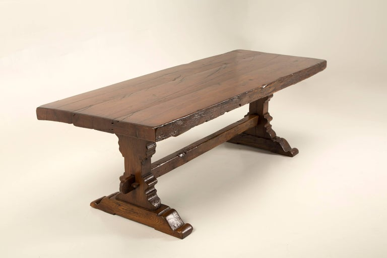 Difficult to determine, if this Antique French trestle dining table dates from the late 1700s or early 1800's, but either way. It just exudes warmth and character, with its craftsmanship. The top of this antique French trestle dining table, was