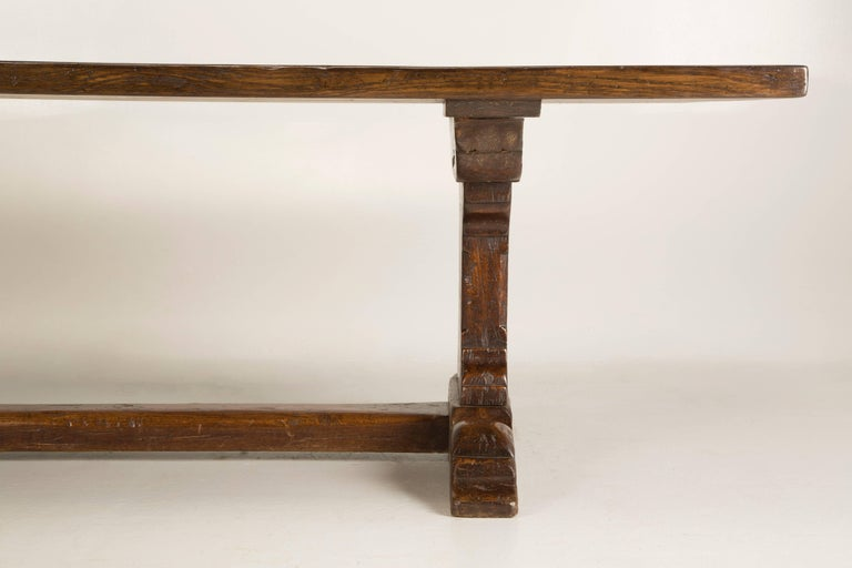 French antique oak trestle dining table, that was made, either in the late 1700s or very early 1800s. We discovered this antique French dining table, near the city of Toulouse, in the southwest region of France. The antique French oak farm table or