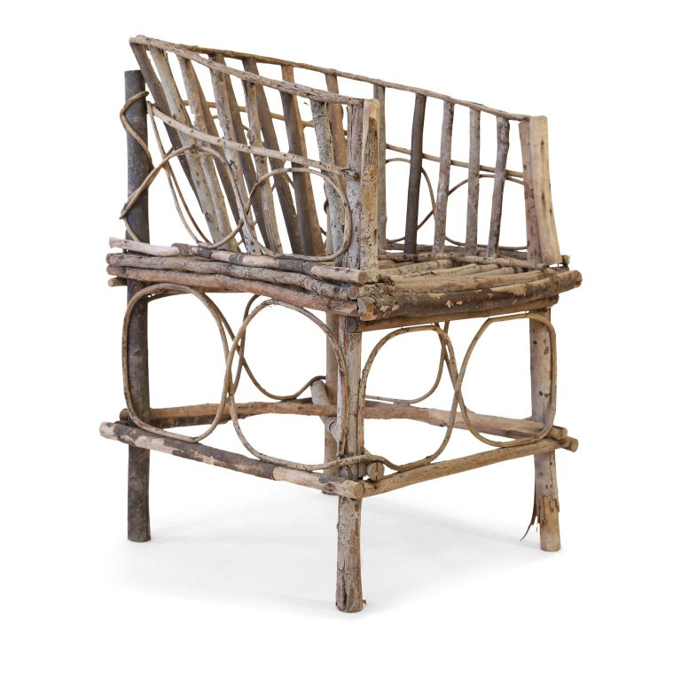 Antique French twig chair, 19th century tramp art chair constructed by hand from branches and twigs by an unknown itinerant folk artist. Retains a beautiful natural, pale patina.