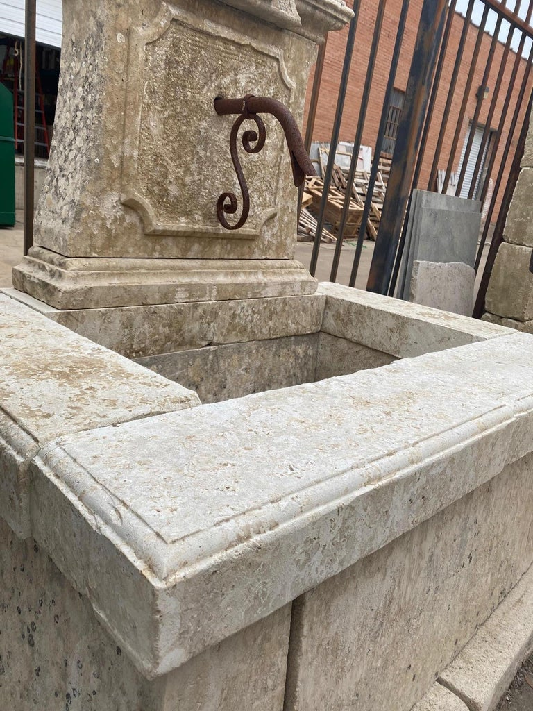 This wall fountain dates back to the 1890s, France, and is made of limestone. Features nice natural patina.