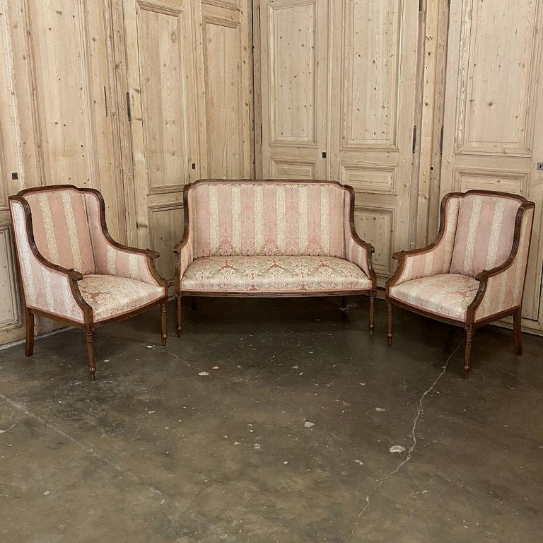 Antique French walnut Louis XVI canapé, sofa is part of an exquisite salon set which includes the pair of side chairs and pair of bergère (armchairs) you can view by clicking on the related products below left. This canapé, sold individually,