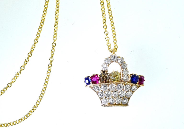 Antique flower basket with 22 white old cut diamonds weighing approximately 1.5 cts., in addition there are 2 natural fancy color diamonds weighing approximately .3 cts.  There are also two natural bright blue sapphires and two natural vivid red