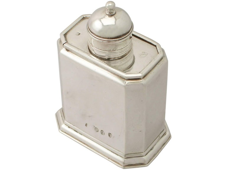 An exceptional, fine and impressive antique George I English Britannia standard silver tea caddy; an addition to our Georgian silver teaware collection.  This exceptional antique George I Britannia standard silver tea caddy has a rectangular form