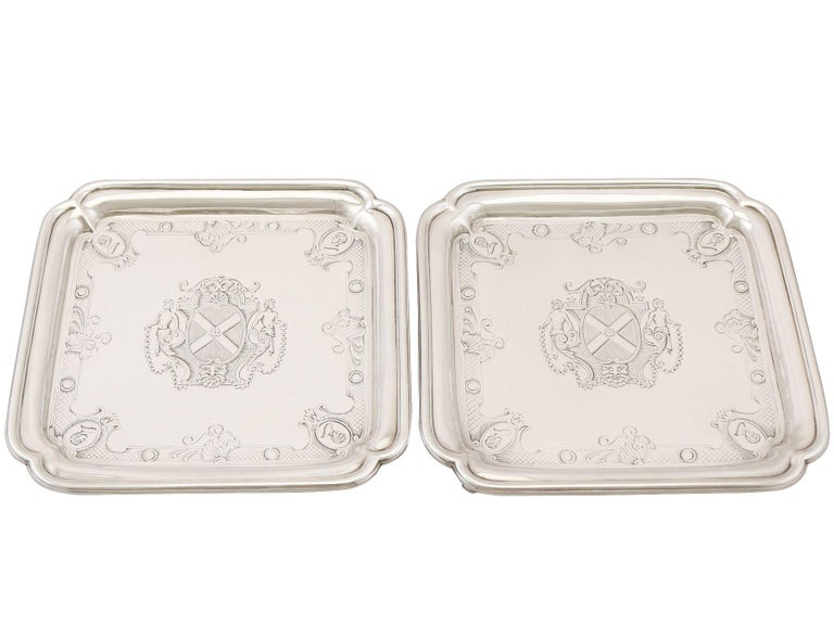 An exceptional, fine and impressive pair of antique Georgian English Britannia silver salvers made by Paul de Lamerie; an addition to our tray and salver collection.  These exceptional antique George II Britannia standard silver salvers have a