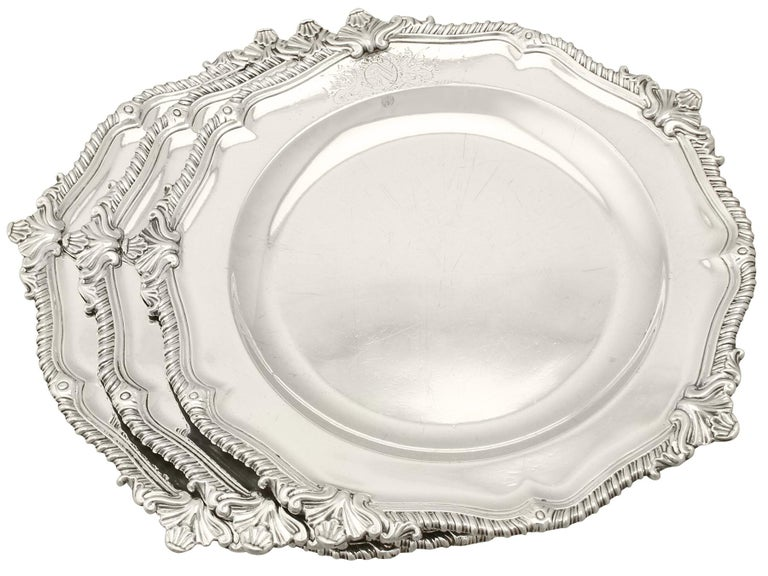 An exceptional, fine and impressive set of three antique Georgian English sterling silver dinner plates/second course dishes, an addition to our range of collectable dining silverware.  These exceptional antique George II sterling silver dinner