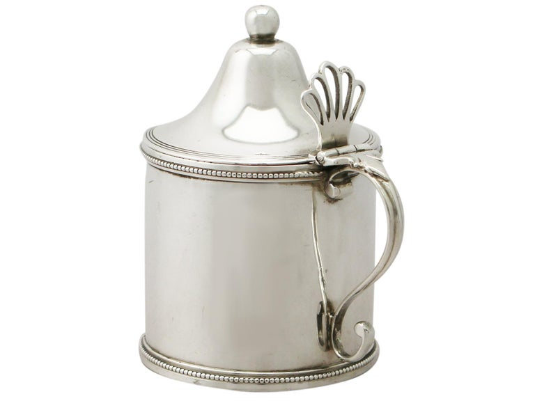 An exceptional, fine and impressive antique George III English sterling silver mustard pot made by Peter and Ann Bateman; an addition to our Georgian silver condiments collection.  This exceptional antique George III sterling silver mustard pot