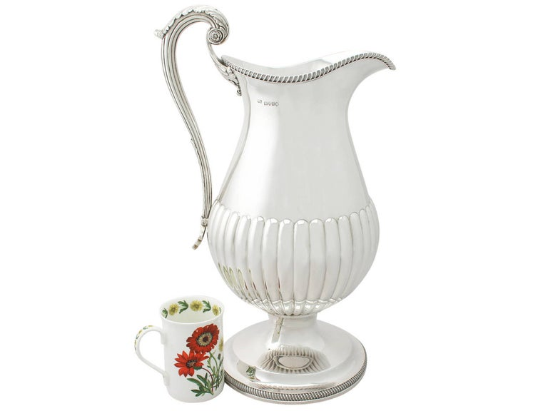 A magnificent, fine and impressive, large antique George IV sterling silver wine ewer/flagon made by William Bateman I; an addition to our range of collectable wine and drinks related silverware  This magnificent antique George IV sterling silver