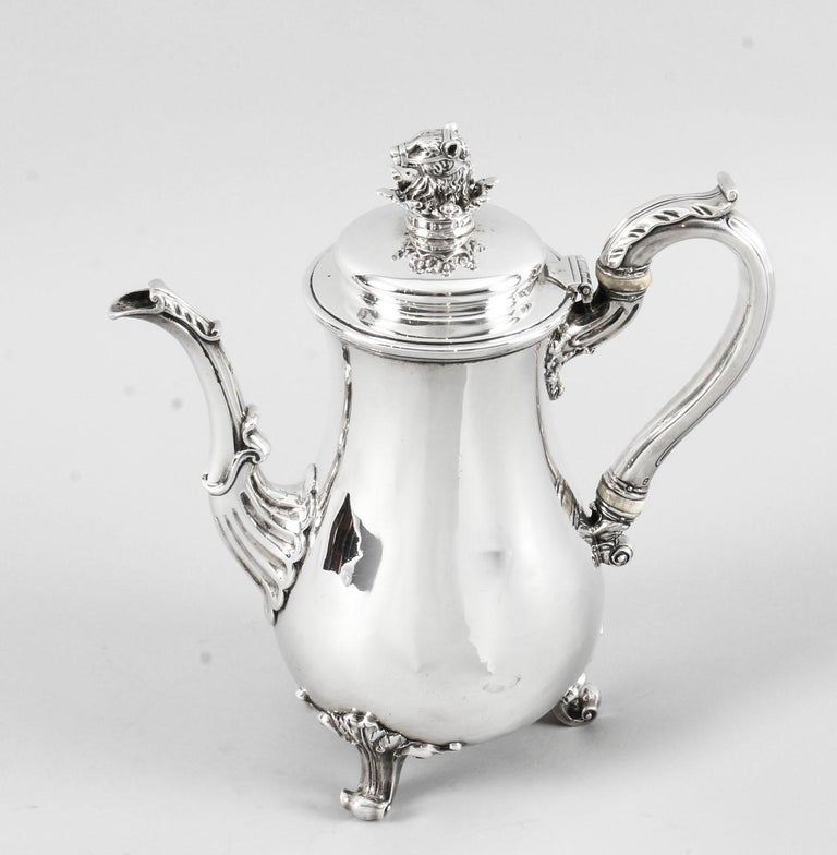 This is a wonderful English antique George IV sterling silver coffee pot by the world famous silversmith Paul Storr.  It has hallmarks for London 1826 and the makers mark of the celebrated silversmith Paul Storr. It bears a wonderful coat of arms