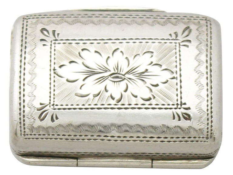 A fine and impressive antique George IV English sterling silver vinaigrette in the form of a purse; an addition to our silver boxes collection.  This antique George IV sterling silver vinaigrette has been realistically modeled in the form of a