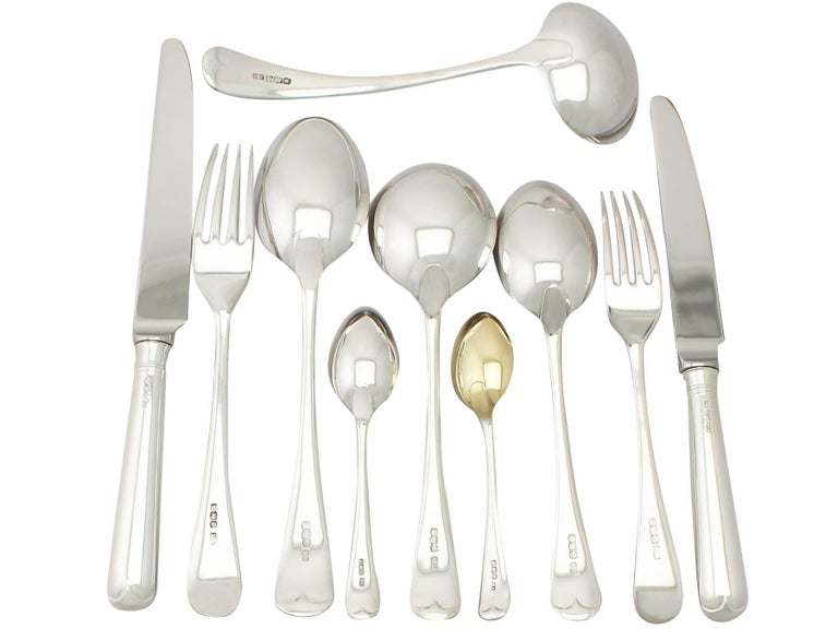 An exceptional, fine and impressive antique George V English straight sterling silver Old English pattern flatware set / service for six persons; an addition to our canteen of cutlery collection.  The pieces of this exceptional, antique George V