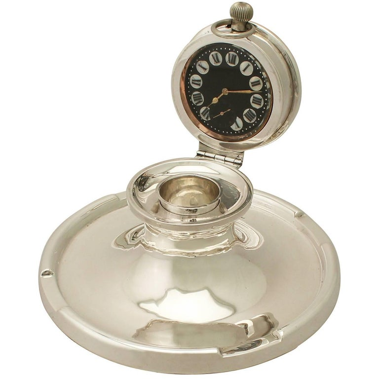 An exceptional, fine and impressive, unusual antique George V English sterling silver capstan watch inkwell; an addition to our ornamental silverware collection.  This exceptional antique George V sterling silver inkwell has a plain circular