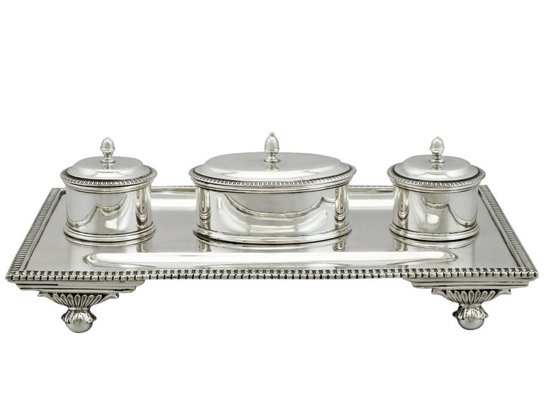 An exceptional, fine and impressive antique George V English sterling silver desk Standish; an addition to our ornamental silverware collection.  This exceptional antique silver desk Standish, in sterling standard, has a rectangular form.  This