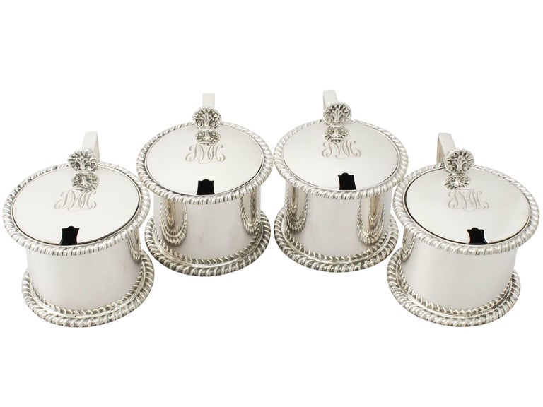 An exceptional, fine and impressive composite set of four antique George V English sterling silver drum mustard pots; an addition to our silver cruet and condiments collection