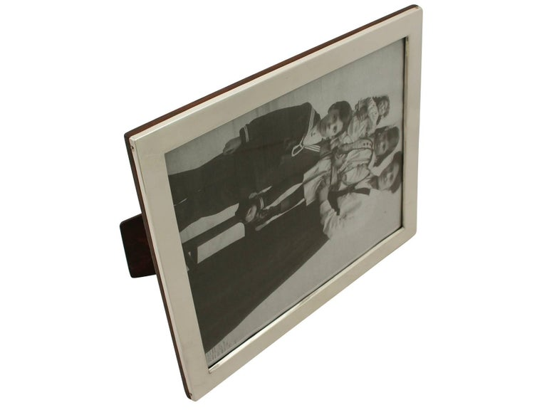 A fine and impressive, large antique George V English sterling silver photograph frame; an addition to our collection of ornamental silverware.  This fine antique George V sterling silver photo frame has a plain rectangular form.  The surface of