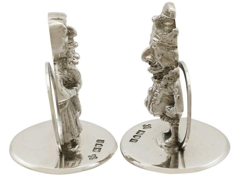 An exceptional, fine and impressive pair of antique George V English cast sterling silver card/menu holders; an addition to our ornamental silverware collection.  These exceptional George V cast sterling silver menu holders have been realistically