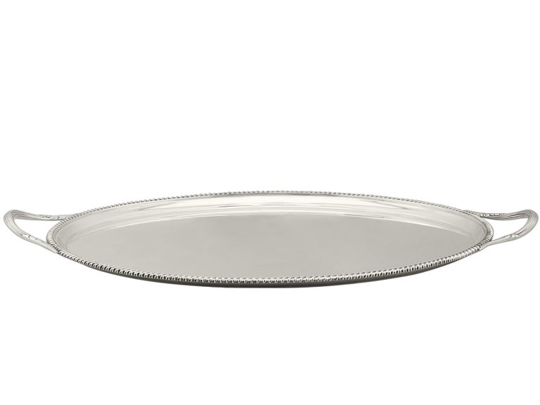 An exceptional, fine and impressive antique George V English sterling silver two handled tray; an addition to our silver tray collection.