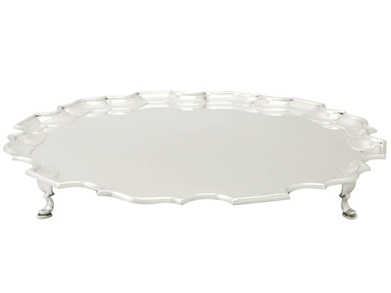 An exceptional, fine and impressive, large antique George VI English sterling silver salver; an addition to our silver dining collection  This exceptional antique George VI English sterling silver salver has a circular shaped form onto four