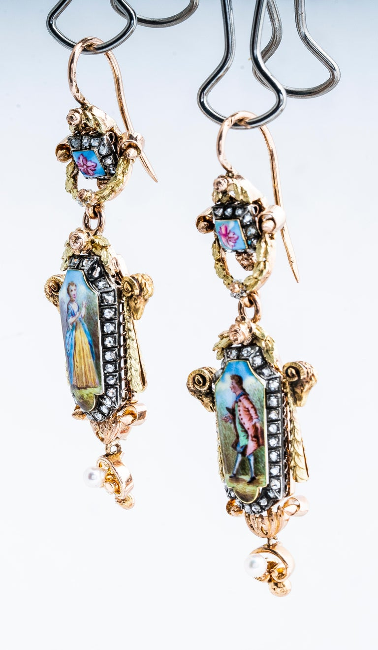 Antique Georgian 18k yellow and rose gold with silver top painted mini portrait man/woman portrait French dangle earrings with shepherd hooks.  Earrings have a man on one earrings and a woman on the other.  Rose cut diamonds encircle the portraits